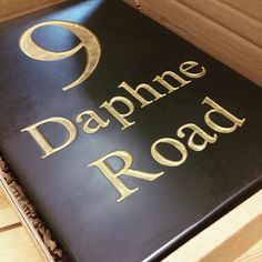 Classic lettering deep engraved into Welsh slate and hand-painted in a rich gold colour. Simple yet very effective.
