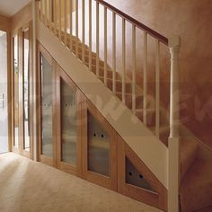 Image: Staircase with understairs concealed storage cupboards with opaque glass doors - EWA Stock Photo Library