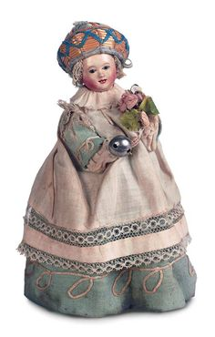 all original French paper mache toddler doll wearing a  padded 'puddinhead' hat (worn to protect a baby's head whilst learning to walk).
