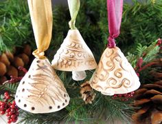 A trio of heavenly bells to tinkle in your home. Each one of them has a slightly different tone.    Made of porcelain. They were rubbed with
