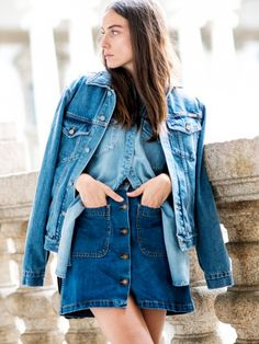 A denim button-up is paired with a denim a-line skirt and a denim jacket.