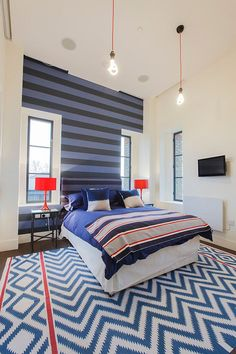 Snazzy use of stripes in the contemporary bedroom in London [From: Joel Antunes photography]