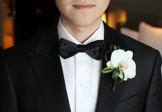 White Orchid Boutonniere // Photo: Esther Sun Photography // TheKnot.com