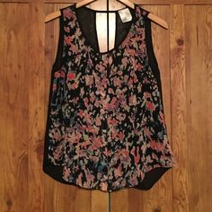 Floral and black shirt Fun floral and black shirt. The shirt is see through with buttons down the front. The back opens as seen in the photos. Business in the front and party in the back😜 the shirt is in pretty decent shape as its only been worn a few times. Jella couture Tops