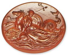A ROMAN CARNELIAN RINGSTONE CIRCA LATE 1ST CENTURY B.C. The flat oval exquisitely engraved with a maenad riding on a hippocamp