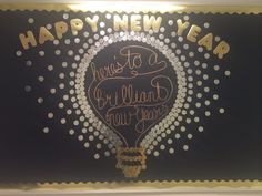 Happy New Year! Here's to a brilliant new year bulletin board. This bulletin board took a lot of artistic effort and time. The dots and letters are made out of silver and gold posterboard, cut with a die cutter. The calligraphy for the bulb was hand drawn with metallic Sharpie. The whole board took almost two days to complete! All the pieces were placed on the board with double stick squares. Very time consuming but so worth it!