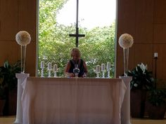 Rose balls and candles for the Altar.  #dsmweddings
