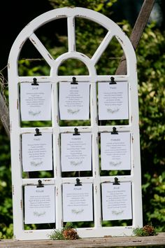 Window Frame Seating Chart - Repurpose a window frame as a seating chart. You can either write on the panes with a glass pen or clip your seating arrangement as shown here.