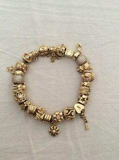 Pandora Gold Bracelet & beads.
