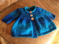 Hand knit girls cardigan.