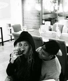 This is a photo that I can truly appreciate.  Every girl just wants a hoodie, a glass of wine, and a guy to find her completely irresistible.