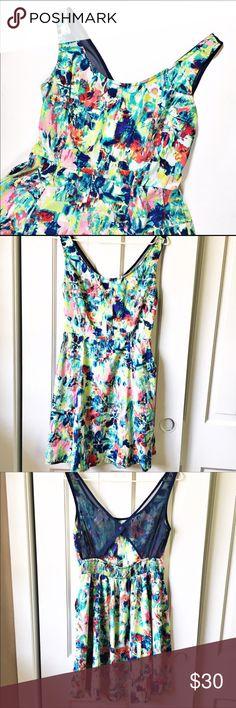 Band of Gypsies cut out back dress with pockets Band of Gypsies floral dress with cut out back • mesh cut out that snaps in the middle • elastic across the mid-back • 2 pockets!! MINT CONDITION!! Too small for me. • This dress is perfect for the summer! ☀️ Band of Gypsies Dresses