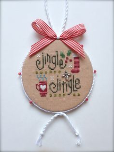 Completed primitive cross stitch Jingle Jingle Christmas flat ornament, designed by Lizzie Kate (book #167 Tiny Tidings XIX) Its hand