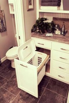 Love this discrete way of hiding the laundry basket!