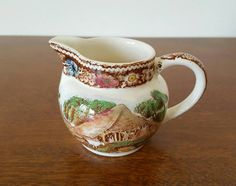 Check out this item in my Etsy shop https://www.etsy.com/listing/259459551/rural-england-midwinter-ltd-pitcher