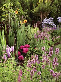 The English countryside inspired the back garden, which boasts an ordered mix of annuals and perennials such as day lilies, impatiens, gladiolas, lavender and roses.
