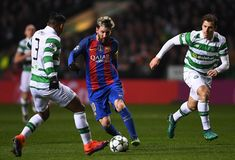 Lionel Messi of Barcelona takes on Emilio Izaguirre of Celtic during the UEFA Champions League Group C match between Celtic FC and FC Barcelona at Celtic Park Stadium on November 23, 2016 in Glasgow, Scotland.