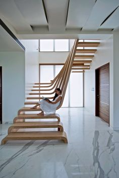 Located in Mumbai in an apartment designed by Arquitectura en Movimiento Workshop, this staircase does away with all ideas of a traditional design and instead becomes a sculptural piece that allows light and air to pass freely. Photo by Bharath Ramamrutham
