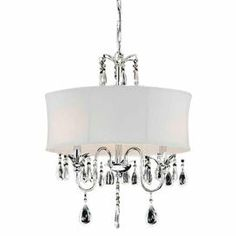 """Chandelier with a white shade and crystal accents. Product: ChandelierConstruction Material: Metal, fabric, crystal and glassColor: Chrome and white Accommodates: (3) 40 Watt E14 candelabra bulbs - not includedDimensions: 24"""" H x 18"""" Diameter"""
