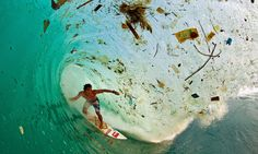 Trash wave Indonesian surfer Dede Surinaya catches a wave in a remote but garbage-covered bay on Java, Indonesia, the world's most populated island   'Water and air, the two essential fluids on which all life depends, have become global garbage cans.' Jacques-Yves Cousteau Photograph: Zak Noyle