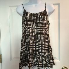 Black & White Silk Tank Size medium silk tank top with adjustable thin straps. Has a super cute ruffle bottom. Material is thin and it comes a  longer in length than normal. 100% silk. Like new condition! Forever 21 Tops Tank Tops