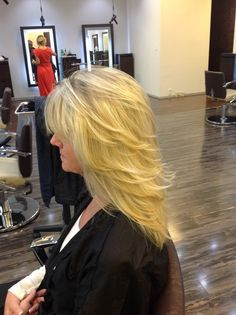 Side view, medium length layers on long hair with pattern matching blonde highlights. @Dawn Edwards-Smith Hair Salon Scottsdale, AZ