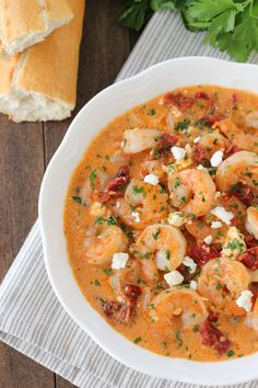 Plump, juicy shrimp smothered in creamy tomato sauce...is your mouth watering yet? Saucy #Shrimp with Sun Dried Tomatoes and Feta is a meal that will please everyone!