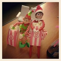 Elf on the Shelf. Twinkle and Jingles found an old box full of my Barbie stuff in the crawl space and they decided to bring out the movie theater. Barbie popped up some popcorn while the elves settled in to their private showing of Elf.