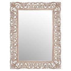Add artful appeal to your entryway or powder room with this classic mirror, featuring a traditional scrolling frame in a neutral palette.  ...