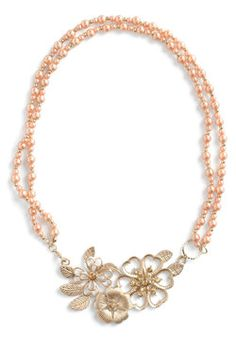 It's a little more pink than what I saw, but oh well. Pearly Bloomer Necklace, #ModCloth