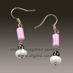 Tungsten earring   Material:ceramic+brass  Color: polished shiny  Plating: no plating   Magnets: No  Length:24mm(not including hook)  Diameter:Pink and black:5mm/whit ceramic:8mm  Diameter: 5mm        white ceramic:8mm  Stone: No stone used