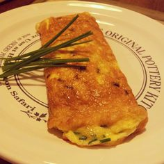 Ham, cheese and ciboulette omelet.