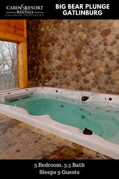 Splash and play at Big Bear Plunge! This luxury Gatlinburg cabin has a private swimming pool, movie theater, pool table, arcade game and much more!