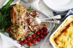 Roasted lamb shoulder with herbs and red wine