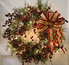 Cedar wreath with weather resistant bow and berry picks, at Treetime in Lake Barrington.