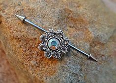 Check out this item in my Etsy shop https://www.etsy.com/listing/261198470/industrial-barbell-flower-rhinestone