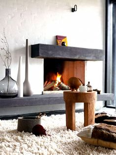 here is a thought for weighting the fireplace.  Maybe play with dark wood and off center it