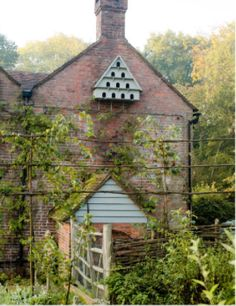 Bat and bird houses are a must in any garden. Woo tiny birds like wrens and finches to eat caterpillars in the garden. Garden Cottage, Cozy Cottage, Home And Garden, Brick Cottage, English Country Gardens, Interior Exterior, Dream Garden, Architecture, Bird Houses