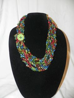 Chain Crochet Ladder Ribbon Yarn Necklace Scarf with Button. $10.00, via Etsy.