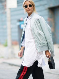 Layering:  light turquoise blue bomber, long length white shirt, blue/red stripes track bottoms ...  (image from whowhatwear)