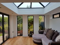 Interior of this orangery in Shirebrook, Nottinghamshire. Grey frames throughout including windows, bi-folding doors, and beautiful roof window for extra light.