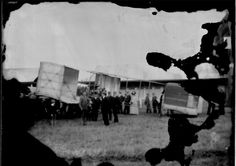 Albert Kimmerling, first plane in Africa. East London, South Africa, on 28 December 1909 in a Voisin biplane he took the first flight . He is the face on left side of picture, with his mechanic in the middle of picture.