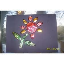 Markers on foil. Cut out flower shape of card, stick foil to back of card.
