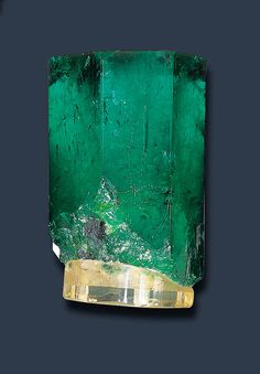 A RARE MUZO EMERALD CRYSTAL   Of rough hexagonal form, weighing approximately 655.40 carats, on a plastic base,