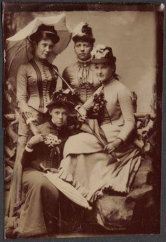 Four women with parasols, tintype portrait.  Circa 1880.