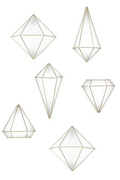 """Set of 3 metal geometric shapes available in brass, black or copper. Whether hung from the ceiling, wall mounted or positioned on a table surface, these geometric shapes add instant update to any room. Set of three.    Three sizes: 10 x 9 x 8 3/4"""" / 6 1/4 x 12 1/4 x 5 1/2"""" / 7 x 7 1/4 x 6 1/4"""" (25.4 x 22.9 x 22.2 cm / 15.9 x 31.1 x 14 cm / 17.8 x 18.4 x 15.9 cm).   Geometric Wall Prisms by Umbra. Home & Gifts - Home Decor - Decorative Objects Washington"""