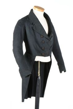 A gentleman's navy wool tailcoat, 1850s. with M-notched lapels, double row of black silk covered buttons, curved back seams, narrow curved cuffs with small button closures to match, heavily padded hips and lower back areas, pocket to inside chest and also concealed within the brown chintz lined tails, chest approx 81cm, 32in.