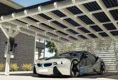 The Solarwatt Carport System uses glass-glass modules to create a modern style solar-based electric vehicle charging and household microgeneration system. The solar energy carport can feed directly into the BMWi wallbox as it charges.