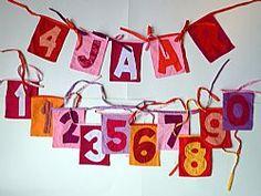 Verjaardags slinger, de cijfers 0 t/m 9 (1 zit er dubbel bij) en de letters JAAR.