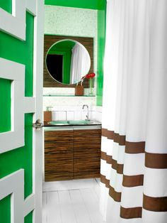 As this 6-foot-by-7-foot Atlanta bathroom demonstrates, sometimes bold color is all you need to make a big statement. Although this space receives no natural light, the bold kelly green walls give it fresh personality. The ultra-white floor and wainscoting counterbalance the green's intensity.